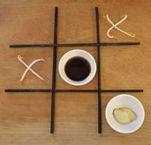 Tic tac toe with asian food — Stock Photo