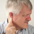 Pain around the ear — Stock Photo #10636015
