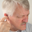 Ear pain in a senior — Stock Photo