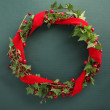 Christmas wreath with velvet ribbon — Stock Photo