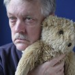 Senior holding teddy bear — Stock Photo