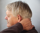Senior man with aching neck — Stock Photo