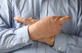 Businessman crosses his fingers and hands — Stock Photo