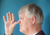 Older man thumbs his nose — Stock Photo