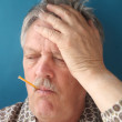 Older man has flu symptoms — Stock Photo #9326687