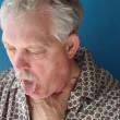 Ill senior man coughing — Stock Photo