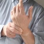 Man has pain in wrist — Stock Photo