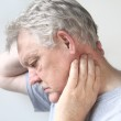 Senior man with sore neck — Stock Photo #9832917
