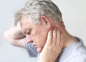 Senior man with sore neck — Stock Photo