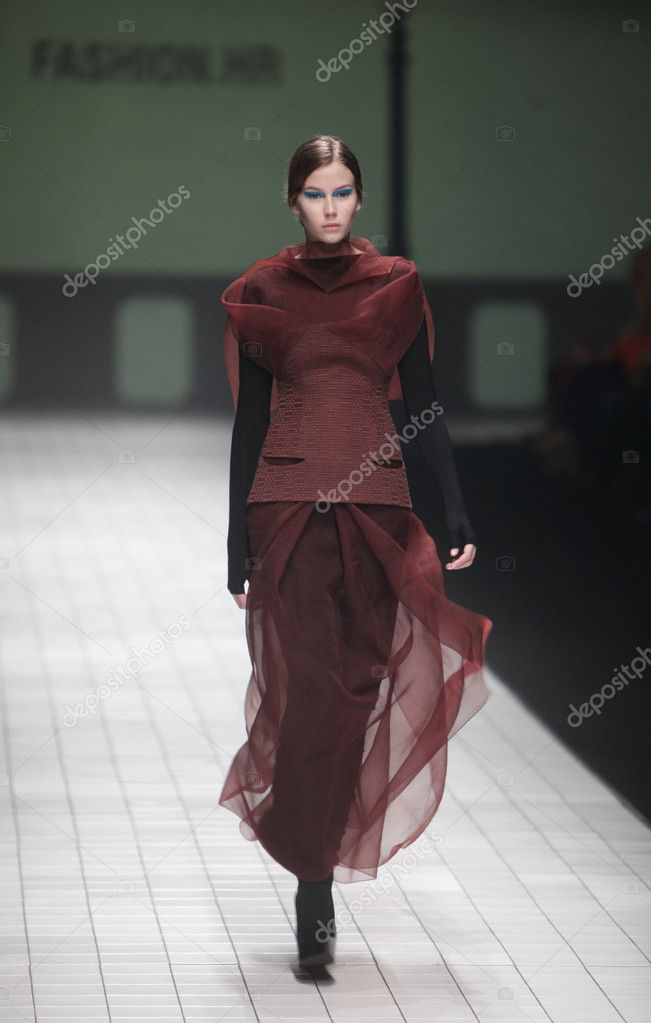 "ZAGREB, CROATIA - MARCH 17: Fashion model wears clothes made by Branka Donassy on ""Dove FASHION.HR"" show on March 17, 2012 in Zagreb, Croatia. — Stock Photo #10033196"