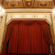 Stock Photo: Old theater stage and red curtain