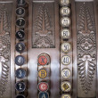 图库照片: Antique store silver cash register buttons