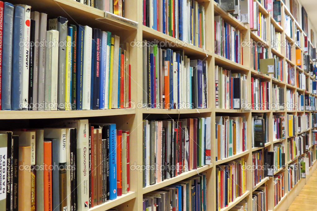Bookshelf in library with many books  Stock Photo #10525865
