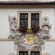 Royalty-Free Stock Photo: Prague, House of the Golden Well, Madonna and Child surrounded by saints