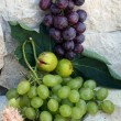 Grapes on a stone background — Stock Photo