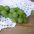 Grape cluster on a white tablecloth — Stock Photo #9030163