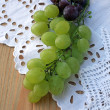 Grape cluster on a white tablecloth — Stock Photo
