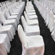 Stock Photo: Rows of white chairs