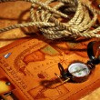Stock Photo: Map of South America, compass and rope