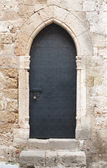 Old black medieval door with sliding door bolt — Stock Photo