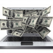 Money and laptop — Stockfoto