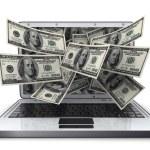 Money and laptop — Stock Photo