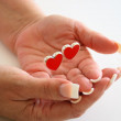 Hands and hearts — Stock Photo