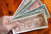 Hand and old cuban money — Stock Photo