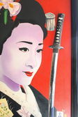 Geisha and sword — Stock Photo