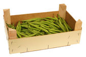 Wooden crate with string beans — Stock Photo