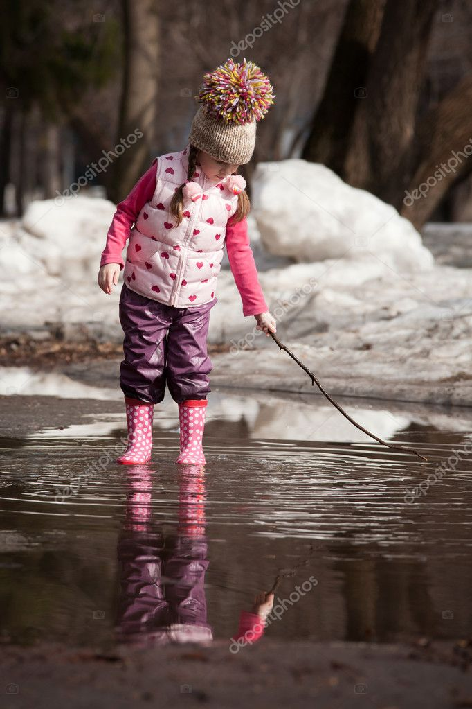 Girl playing in puddles  Stock Photo #8545059