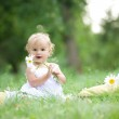 Baby sitting on green grass — Stock Photo #9723576