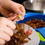 Almonds peeling — Stock Photo