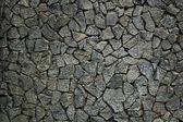 Grungy weathered stone rubble mosaic wall surface. — Stock Photo