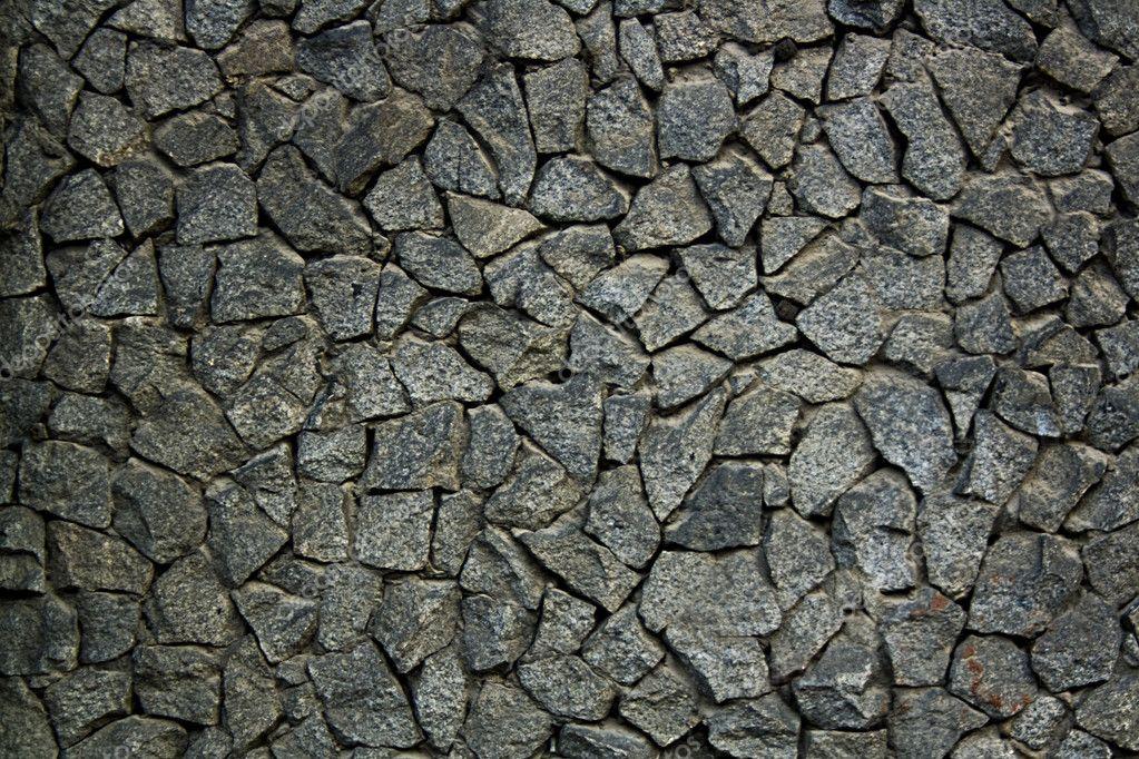 Rubble Stone Elevation Symbol : Grungy weathered stone rubble mosaic wall surface — stock