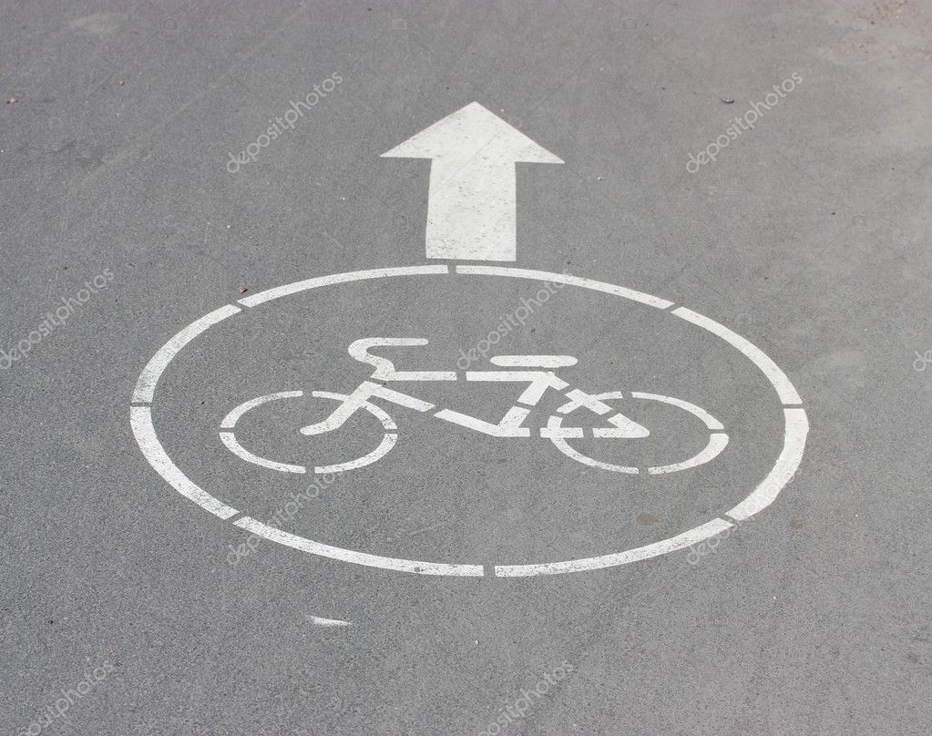 White arrow and sign a bicycle on asphalt. — Stock Photo #10529734