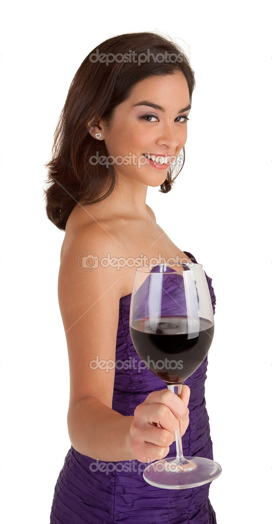 A beautiful woman in a classy dress is serving a glass of wine. — Stock Photo #10428716