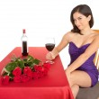 Woman Being Courted by Someone with Flowers an Wine — Stock Photo