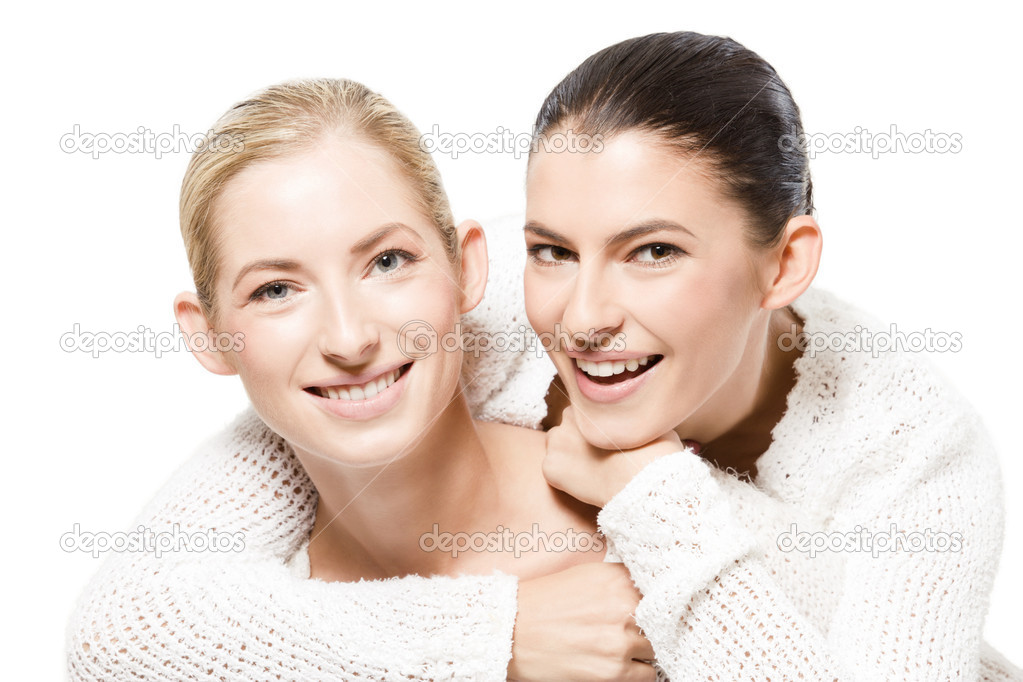 Studio portrait of two young happy caucasian women, isolated over white  Stock Photo #8781648