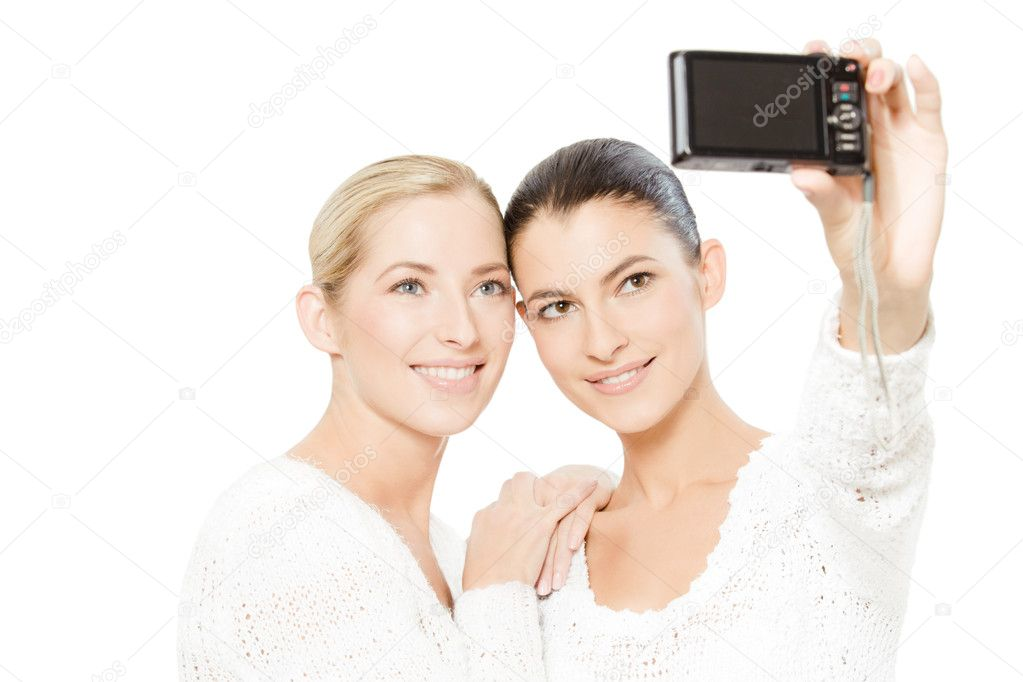 Two young women taking pictures of themselves, isolated on white — Stock Photo #8781803