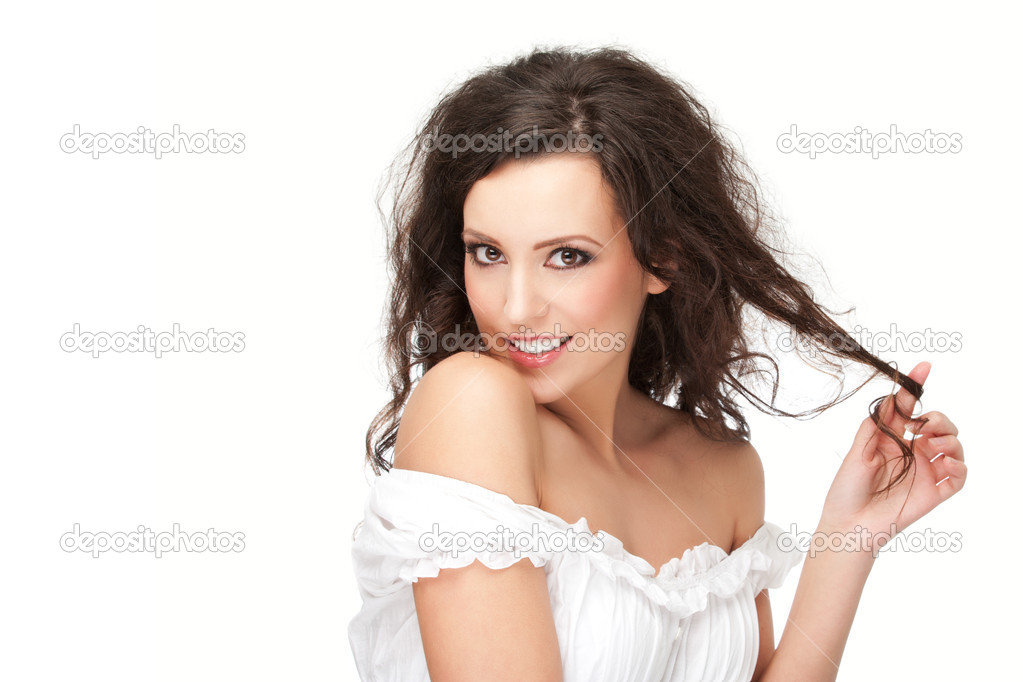 Gorgeous brunette posing, over white background, studio shot  Stock Photo #8782094