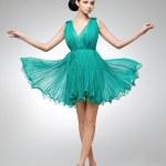 Brunette in teal dress — Stock Photo