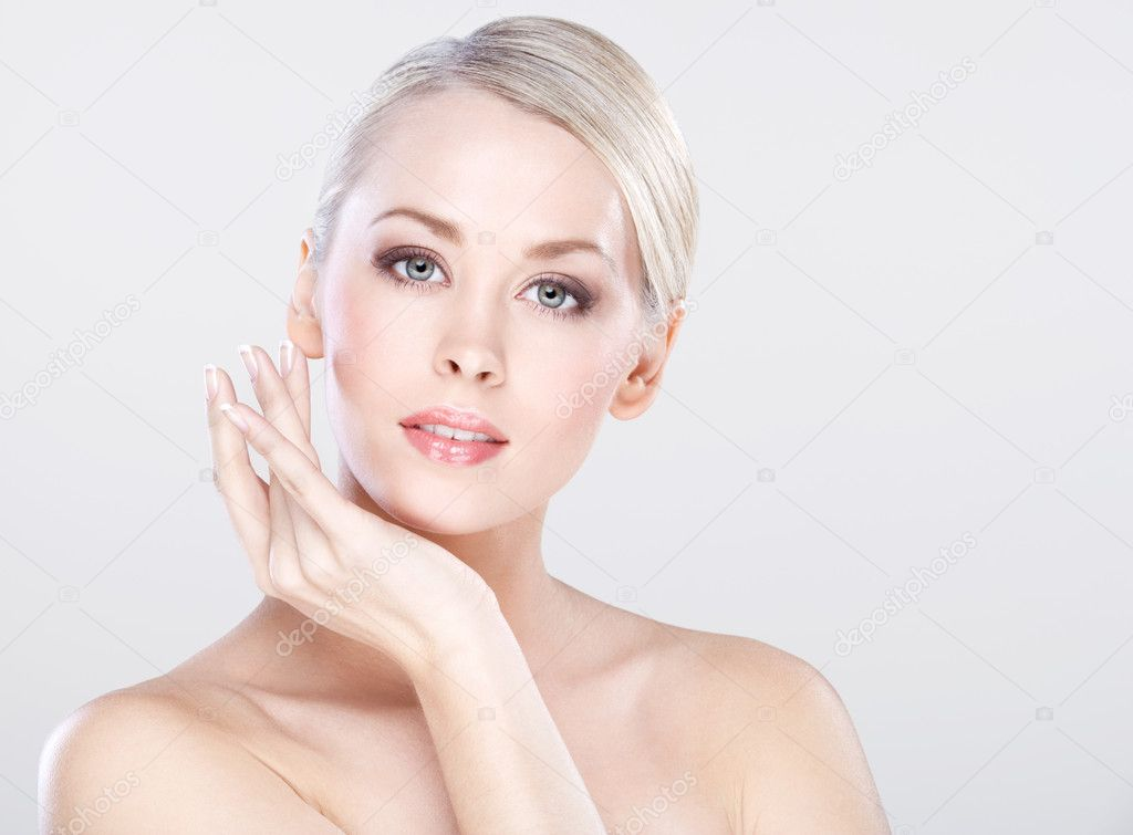 Young beautiful caucasian woman with natural makeup posing in the studio  Stock Photo #8984959
