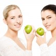 Two smiling women with apples — Stock Photo