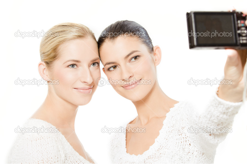 Two young women taking pictures of themselves, isolated on white — Stock Photo #9407441