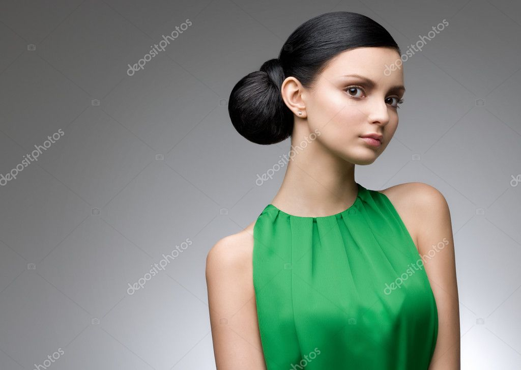 Young beautiful woman in green dress, studio shot — Stock Photo #9461595