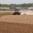 Large Tractor Harrowing a Field — Stock Photo