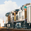 Freight Train Returning Empty Coal Cars - Stock Photo