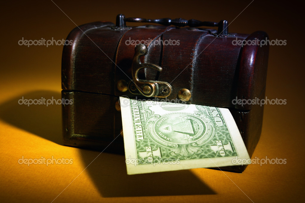 Wood cashbox isolated on brown — Stock Photo #10668144
