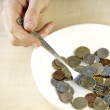 Eating some coins - Stockfoto